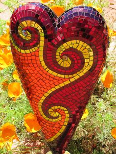 "Heart on Fire- 22""Hx15""w x 3.5""D. Made in Passiflora Mosaics 3-D styrofoam/concrete sculpture workshop then applied mosaic afterwards. This can be used indoors or out."