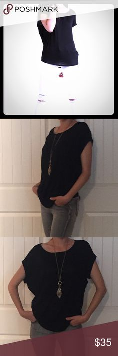 """✨New Listing✨ Short Sleeve Classic Tee Another must have classic tee. So soft and comfortable and lays on the body perfectly.  ⭐️Cuffed Sleeves ⭐️Rayon/Spandex ⭐️Casual yet Stylish ⭐️Round Neck ⭐️Cuffed Sleeves  (If """"applicable""""this item includes sales tax  to the nearest mil') Tops Tees - Short Sleeve"""