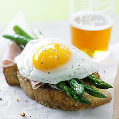 Looking for a healthy Eggs Benedict?  Then try these great Parmesan Toasts with Asparagus, Proscuitto, and Eggs.