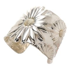 Tiffany & Co. Large Daisy Cuff Bracelet. Tiffany & Company sterling silver with Gold Wash Accents Daisy Cuff Bracelet. Measuring 2 inch wide. c 2000