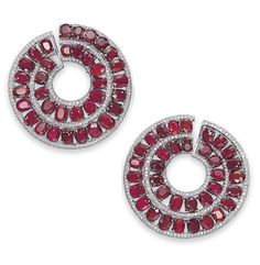 A PAIR OF ATTRACTIVE RUBY AND DIAMOND EAR CLIPS, BY MICHELE DELLA VALLE  Each hoop designed as a double series of oval-shaped rubies, within micro pavé-set diamond borders, mounted in 18k white gold, 5.2 cm long, in a fitted Michele della Valle black suede box Signed Michele della Valle