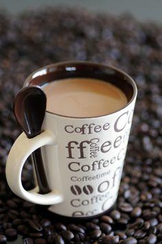 Coffee Mug with built-in Spoon. (hkfioregiallo | Flickr)