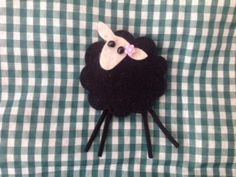 sheep brooch. Made this for my American friend- posted it to her as a gift. Made it up from a Fibrespace kit.