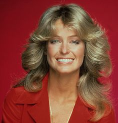 Farrah Fawcett--Every girl wanted her hairstyle.  Achieving it took a  set of hot rollers.  Once they cooled, you took them out, bent over and shook your head to loosen the curls, flipped your head up quickly, arranged the curls, and finished off the look with a ton of Final Net!