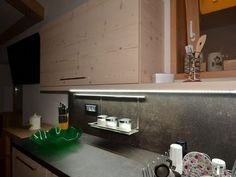 Silver spice rack applied on the back of a kitchen.