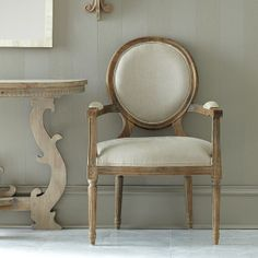 Louis XVI End Chair: Simpler, less ornate design characterizes the style of Louis XVI furniture—elegance, yet simplistic linen upholstery, weathered oak finish, and chair legs that imitate Roman columns. ($249.00)