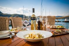 Mushroom Pasta with a great view to the Wörther See Mushroom Pasta, Great View, Alcoholic Drinks, Stuffed Mushrooms, Table Settings, Food, Environment, Alcoholic Beverages, Meal