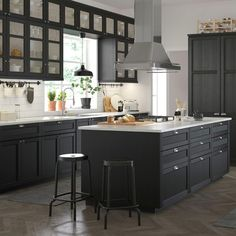 Add a taste of traditional craftsmanship to your kitchen. High quality LERHYTTAN doors in black stain are designed to stand the test of time. With its distinct traditional character and solid wood frame LERHYTTAN creates a cosy kitchen with rustic charm. Cosy Kitchen, Kitchen Cupboards, New Kitchen, Kitchen Decor, Kitchen Walls, Kitchen Ideas, Black Kitchens, Home Kitchens, Black Ikea Kitchen