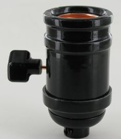 BLACK PORCELAIN ANTIQUE REPRODUCTION ON-OFF LAMP SOCKET WITH 1/8IPS CAP. RATED MAXIMUM 250W 250V, UL LISTED E224663.