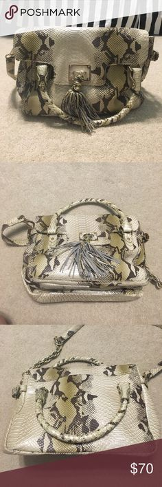 Snake-skin purse Elliot Luca snake skin, double pocketed purse. In perfect condition. Never used. Elliott Lucca Bags