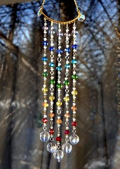 This would be a great way to bring healing chakra colors into your home with a Chakra Suncatcher in your window…JW This would be a great way to Wire Crafts, Bead Crafts, Jewelry Crafts, Chakra Colors, Diy Wind Chimes, Hanging Crystals, Beaded Curtains, Wire Art, Beads And Wire