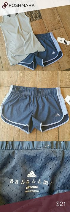 "NWT ADIDAS SHORTS Brand new Adidas M10 Performance shorts.  Built in brief Colors are blue with light blue/lavender stripe 3"" Inseam Adorable #3 cutout through out No rips, stains or defects. Smoke free home Adidas Shorts"