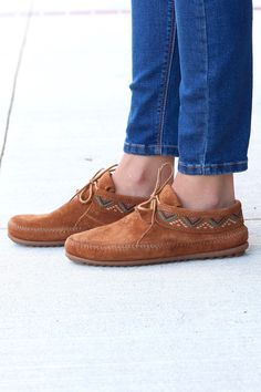 Trek forth in comfort. Accent your look with mosaic-inspired styling. Featuring soft suede construction with a padded footbed and sporty rubber sole, this footwear combines fashion and comfort. Finish