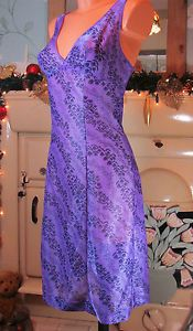 VTG PURPLE SPARKLY GLOSSY SOFT SLIPPY NYLON FULL SLIP NIGHTIE GOWN DRESS R11475 For more pictures of the same please visit any of my blogs: Tumblr  link   http://sangriasuzie.tumblr.com/ Wordpress blog link  http://sangriasuzie.org/ http://stores.ebay.co.uk/Sangriasuzies-Emporium http://www.sangriasuzie.com/ If any of the  items pictured in this blog/pin take your fancy they can be bought from one of the above addresses.  Or e-mail me at drobertshq@hotmail.com   if you need more info.