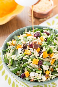 You will love this fall lighter salad with roasted butternut squash, spinach, orzo, craisins and gorgonzola cheese topped with a creamy maple vinaigrette.