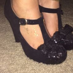 Betsy Johnson heels Unique and chic Black suede T-Strap sequin bow pumps. Worn twice. Excellent condition. The second picture is the shoes in Pink for a clearer picture of the shoes and its details. Betsey Johnson Shoes Heels
