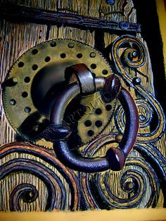 Old door handle: beautiful!  muted/natural purple-blue-orange-green