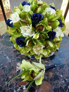 Green Cymbidium orchids, navy blue rosebuds, ivory trellis roses