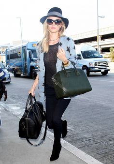 Rosie Huntington-Whiteley's Rag & Bone hat; Saint Laurent sweater; Chanel sunglasses; Jennifer Fisher choker; Balenciaga Voyage Bag ($1875); Givenchy bag.