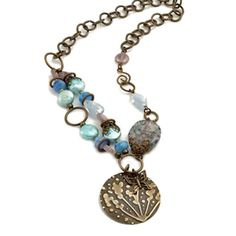 Glimmering Waters Necklace--I just learned that my Big Shot can emboss metal like this.I love the asymmetry of this necklace. Diy Jewelry Necklace, Necklace Designs, Jewelry Crafts, Beaded Jewelry, Jewelery, Beaded Bracelets, Jewelry Ideas, Blue Necklace, Jewelry Supplies