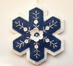 Blue and White Wool Felt Snowflake Ornament, Embroidered Snowflake, Sequined Snowflake, Christmas tree ornaments is part of Wool Felt crafts - bluesnowflakeornamentpdfpattern ref shop home active 1 Felt Christmas Decorations, Felt Christmas Ornaments, Snowflake Ornaments, Handmade Ornaments, Handmade Christmas, Snowflakes, Beaded Ornaments, Christmas Projects, Holiday Crafts