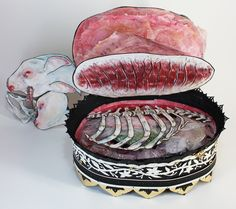 Gorgeous pop-up book lets you dissect a unicorn organ by magical organ [ a creepy cool coffee table book. ]
