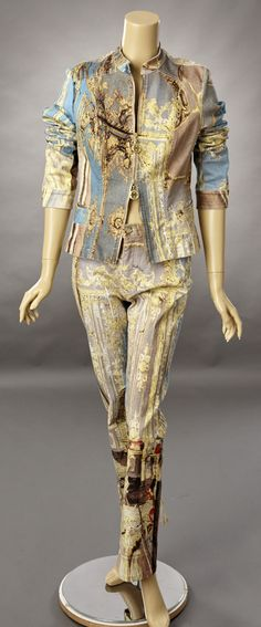 1990s Roberto Cavalli print denim jeans and matching jacket in a large. The print is of a music room from a palazzo. The print is accented by a scattering of gold metallic threads placed throughout th