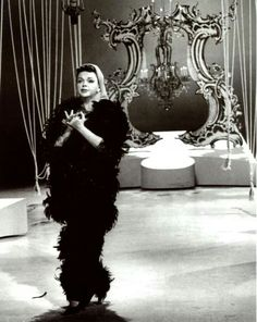Judy Garland in a feathered outfit