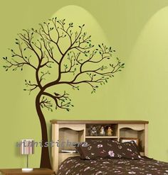 I like this for the laundry room wall....Vinyl Wall Decal tree decal Nature Design Tree Wall Decals Wall stickers Nursery wall decal wall art------ spring tree. $69.00, via Etsy.