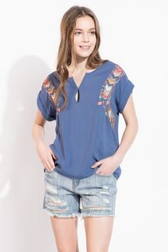 Love the colorful chevron embroidery and keyhole detail! Gorgeous boho inspired top.