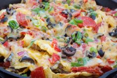 Campfire Pizza Nachos Recipe - looks good, i wonder about cooking sauce ahead of time? Pizza Nachos, Iron Skillet Recipes, Skillet Meals, Skillet Nachos, Skillet Cooking, Campfire Pizza, Campfire Recipes, Campfire Breakfast, Brit
