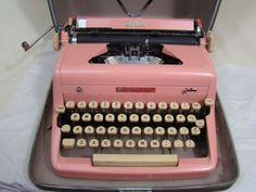Pink Royal Quiet DeLuxe portable typewriter.