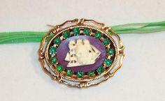 40 x 30 resin cameo, rhinestones and metal pendant