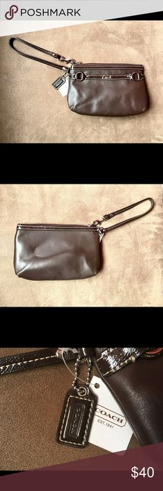 New With Tags Chocolate Coach Wristlet This beautiful bag comes with tags attached, and inserts! It's the perfect gift, for your loved ones or yourself. It is flawless, and comes with a convenient carry handle. Coach Bags Clutches & Wristlets