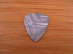 Coolest pick ever. Muonionalusta Iron Meteorite Guitar Pick. $50.00, via Etsy
