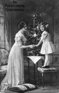 История в фотографиях: зима, рождественские ёлки и мода в 1900-х годах