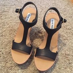 """Steve Madden Iluvit wedges. Steve Madden Iluvit Wedges. Black. Size 8. Never worn. These will fit for a size 7.5 or 8 foot. No box. {From website} Cork wedge heel, 5""""; platform: 1.5"""" Faux leather upper. Side adjustable buckle. Steve Madden Shoes Wedges"""
