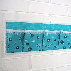 Oppbevaringslommer til å henge på veggen