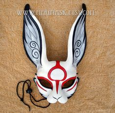 Japanese Sumi-e leather rabbit mask by merimasks equipment gear magic item | Create your own roleplaying game material w/ RPG Bard: www.rpgbard.com | Writing inspiration for Dungeons and Dragons DND D&D Pathfinder PFRPG Warhammer 40k Star Wars Shadowrun Call of Cthulhu Lord of the Rings LoTR + d20 fantasy science fiction scifi horror design | Not Trusty Sword art: click artwork for source
