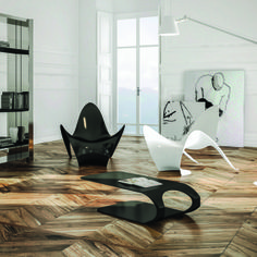 Living room with Manta armchairs, Suspended coffee table and Winglets bookcase