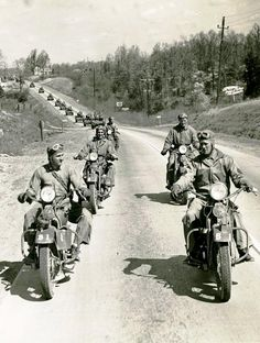 WWII Motorcycle Squad leading a convoy. Talk about the original bad boys.