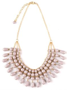 Fair Trade Blush Necklace Wear our Fair Trade Blush necklace for a classically feminine look. Glass, blush colored beads on a brass chain lay beautifully on the chest. Pair with a sundress for an effortlessly chic summertime ensemble.