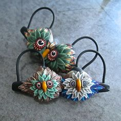 A pair of owl themed artisan 'bra' pins by Deb Hart