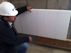 Dean showcasing the EX Panel- designed with an extra 1/2 in of foam and moisture control channels.