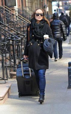 Olivia Wilde.. Gerard Darel Double Breasted Coat, Acne Short Pistol Boots in Black, Proenza Schouler PS1 Bag, and Karen Walker Deep Freeze Sunglasses..