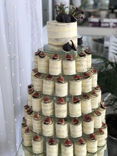 This fig-themed cake with lots of mini cakes underneath so that no one has to share a slice. 17 Wedding Cakes That You Thought Only Existed In Your Dreams Mini Wedding Cakes, Creative Wedding Cakes, Floral Wedding Cakes, Wedding Cakes With Cupcakes, Wedding Cake Designs, Mini Cakes, Wedding Cake Toppers, Floral Cake, Purple Wedding