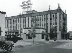 This is the striking Beverly Professional Building, built in 1926 at the corner of Camden Drive and Brighton Way in Beverly Hills as a mixture of office and retail space in the fanciful Churrigueresque style. Amazingly, it's still there today, though it's lost the delicate spirals reaching from the roof. This photograph is dated in the 1930s.