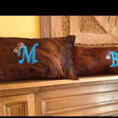 Cowhide throw pillows with monogrammed initial with vintage jewels
