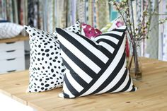 Black & White Stripe Pillow with opposing diagonal lines. So fine and so impacting! Available at www.tonicliving.com #tonicliving #blackandwhitestripes #blackandwhite #interiors #interiordecor #homedecor