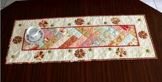 """""""Off on a Tangent"""" - With French braid, applique and pretty embellishments, this classic table runner will enhance any decor. Val Laird Designs"""